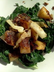 pan roasted potatoes, apples, and fennel on a bed of blanched Swiss chard